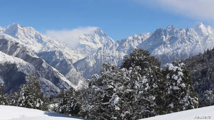 Snow-covered Nanda Devi mountain is seen from Auli town