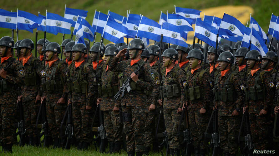 Troops attend a military ceremony where El Salvador's President Nayib Bukele (not pictured) is being presented with the commander's baton, in San Salvador, El Salvador, June 11, 2019.