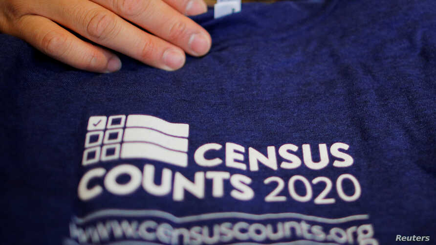 FILE - T-shirts are displayed at a community activists and local government leaders event to mark the one-year-out launch of the 2020 Census efforts in Boston.