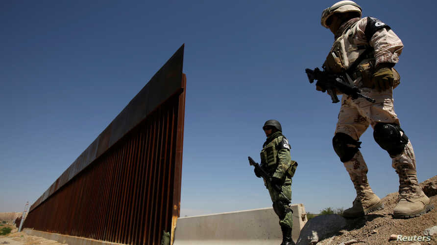 Mexico's National Guard patrol along the border between Mexico and the U.S., in Anapra