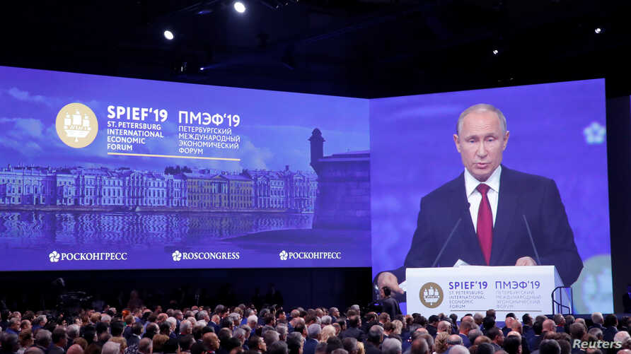 Russian President Vladimir Putin delivers a speech during a session of the St. Petersburg International Economic Forum