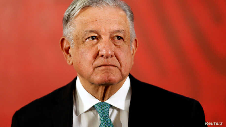 FILE - Mexico's President Andres Manuel Lopez Obrador attends a news conference at the National Palace in Mexico City, June 10, 2019.