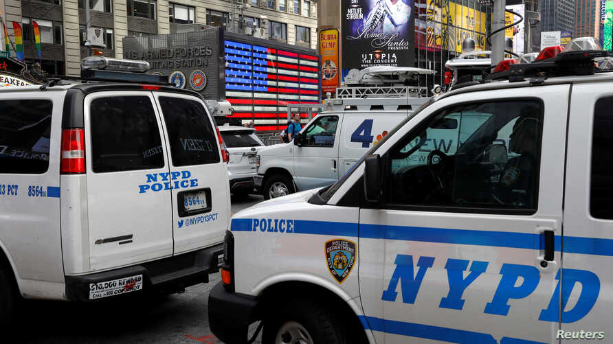 NYPD vehicles patrol in Time Square in New York