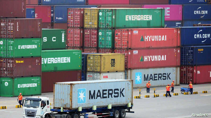 Truck transports a container at a port in Qingdao, Shandong