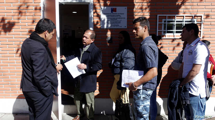 Venezuelans line up at the Chile Consulate to get migration documents in La Paz, Bolivia, July 1, 2019.