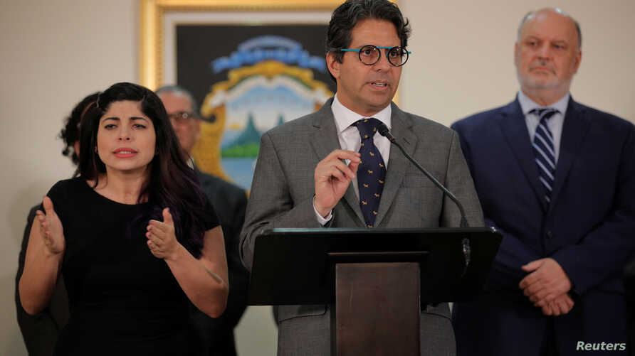 """Costa Rica's Education Minister Edgar Mora speaks to the media after resigning for protests over his """"progressive"""" ideas at the presidential house in San Jose, Costa Rica, July 1, 2019."""