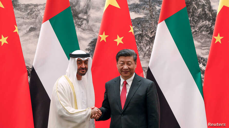 Abu Dhabi's Crown Prince Sheikh Mohammed bin Zayed Al Nahyan shakes hands with Chinese President Xi after witnessing a signing ceremony in Beijing, July 22, 2019.