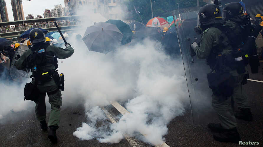 Demonstrators are caught in tear gas during a protest against the Yuen Long attacks in Yuen Long, New Territories, Hong Kong, July 27, 2019.