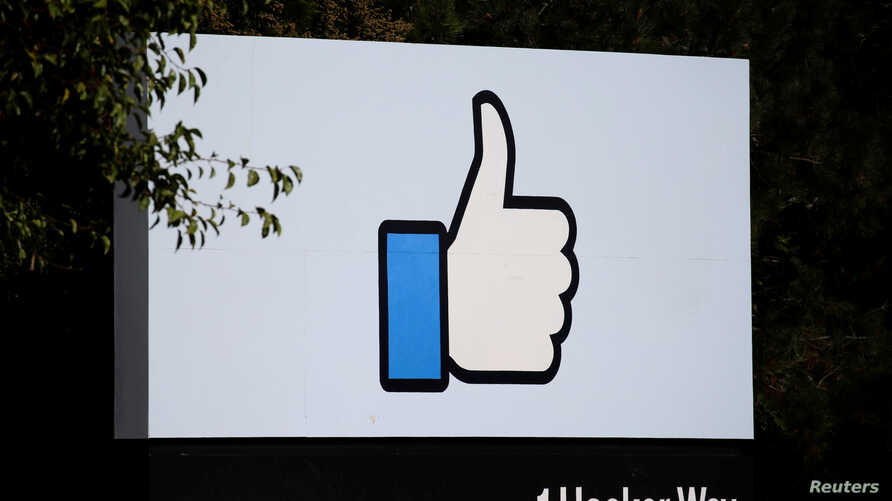FILE - The entrance sign to Facebook headquarters in Menlo Park, Calif., Oct. 10, 2018.