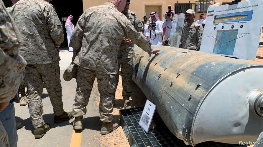 Saudi-led coalition officials show to U.S. Central Command chief General Kenneth McKenzie an exibit of weapons and missiles that is used by Houthi attacks against Saudi Arabia, in Riyadh