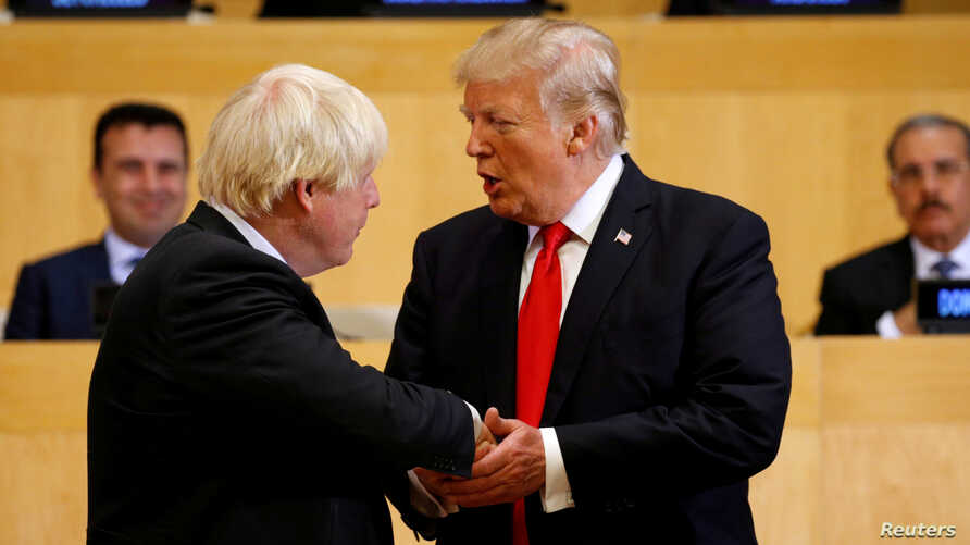 FILE - U.S. President Donald Trump shakes hands with Boris Johnson, left, then the British foreign secretary, as they take part in a session on reforming the United Nations at U.N. Headquarters in New York, Sept. 18, 2017.