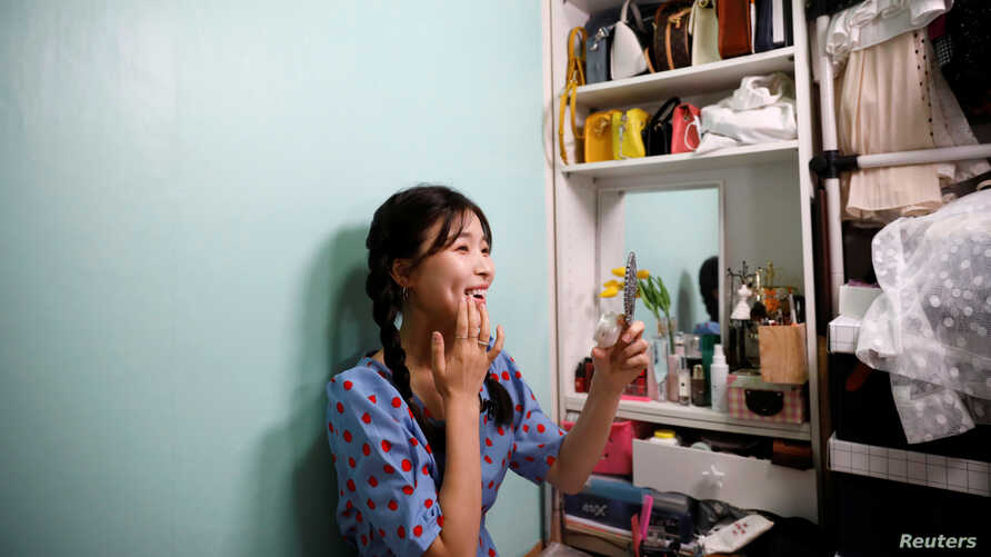 Kang Na-ra, a North Korean defector who is now a beauty YouTuber, puts on her makeup with North Korean cosmetic products, in Seoul, South Korea, June 11, 2019.