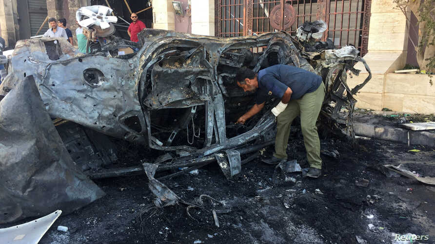 REFILE - REMOVING RESTRICTIONS A security official inspects the site where a car bomb exploded in Benghazi, Libya August 10, 2019. REUTERS/Stringer