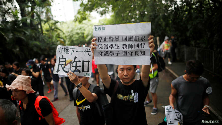 Teachers protest against the extradition bill during a rally organized by Hong Kong Professional Teachers' Union in Hong Kong, Aug. 17, 2019.