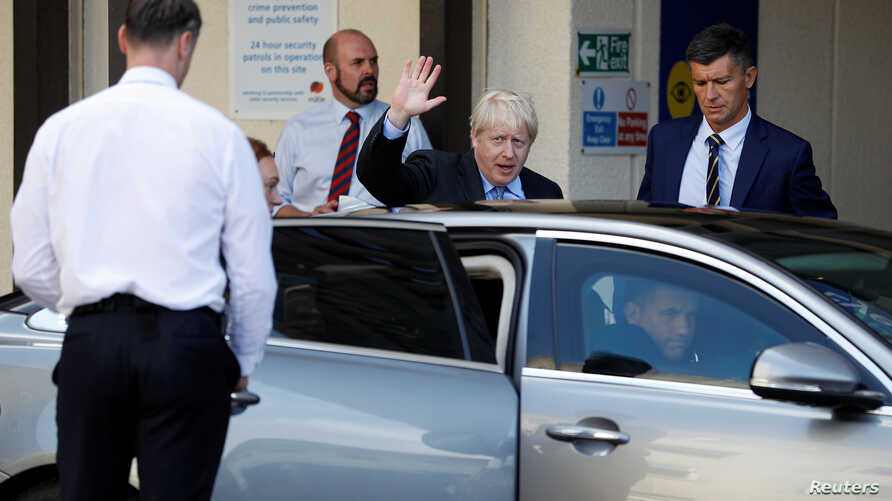 Britain's Prime Minister Boris Johnson leaves after his visit to the Royal Cornwall Hospital in Truro, Britain, August 19, 2019.  REUTERS/Peter Nicholls/Pool