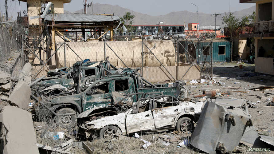 Damaged police vehicles are seen at the site of a blast in Kabul, Afghanistan, Aug. 7, 2019.