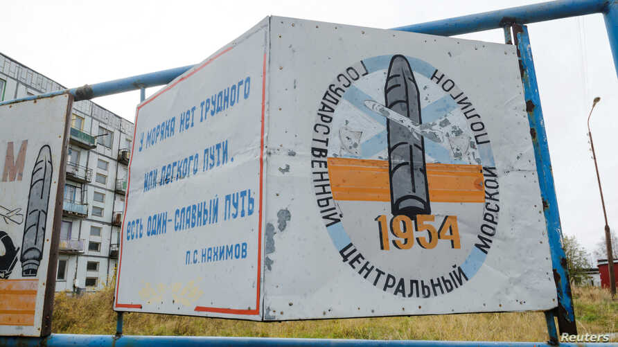"""A view shows a board on a street of the military garrison near the village of Nyonoksa in Arkhangelsk Region, Russia, Oct. 7, 2018. The board reads: """"State Central Naval Range."""""""
