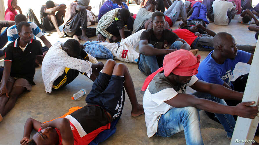 Migrants are seen after being rescued by Libyan coast guard in Khoms, Libya August 27, 2019. REUTERS/Ayman Sahely