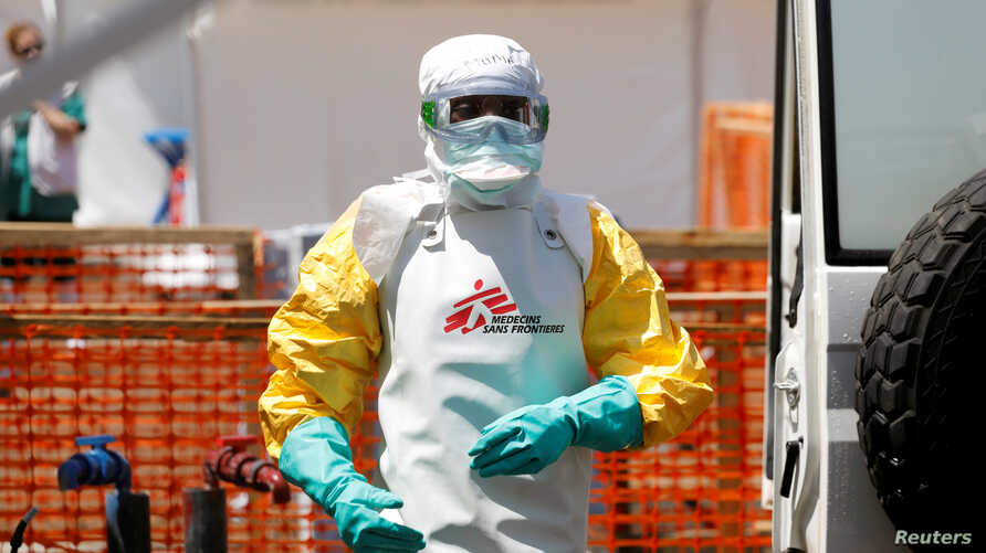 FILE PHOTO: A health worker dressed in protective suit disinfects an ambulance transporting a suspected Ebola patient to the newly constructed MSF (Doctors Without Borders) Ebola treatment centre in Goma, Democratic Republic of Congo, August 4, 2019.REUTERS/Baz Ratner/File Photo