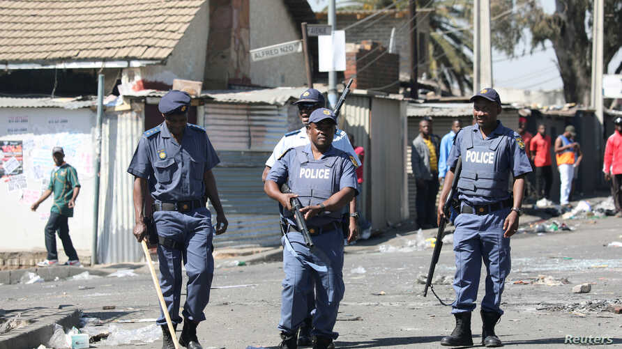 FILE PHOTO: Police patrol the streets after overnight unrest and looting in Alexandra township, Johannesburg, South Africa, September 3, 2019.  REUTERS/Marius Bosch/File Photo