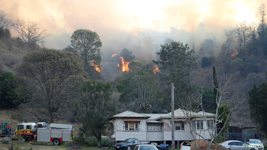 Fire and Emergency crew battle bushfire near a house in the rural town of Canungra in the Scenic Rim region of South East Queensland, Australia, September 6, 2019.