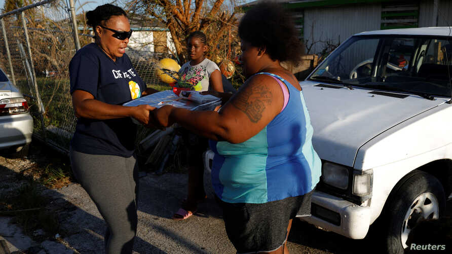 A volunteer of the NGO World Central Kitchen delivers food, after Hurricane Dorian hit the Abaco Islands in Spring City, Bahamas, September 10, 2019. Picture taken September 10, 2019. REUTERS/Marco Bello