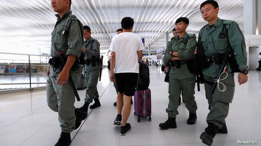 Riot police patrol inside Hong Kong International Airport in Hong Kong, China September 22, 2019. REUTERS/Jorge Silva