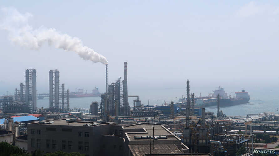 China National Petroleum Corporation (CNPC)'s Dalian Petrochemical Corp refinery is seen near the downtown of Dalian in…
