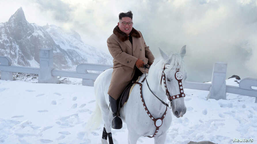 North Korean leader Kim Jong Un rides a horse during snowfall in Mount Paektu in this image released by North Korea's Korean…