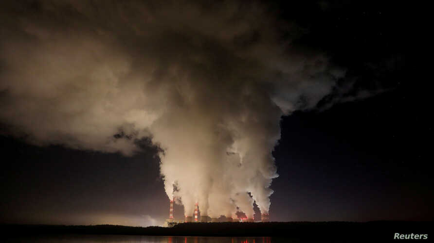 FILE PHOTO: Smoke and steam billows from Belchatow Power Station, Europe's largest coal-fired power plant operated by PGE Group…