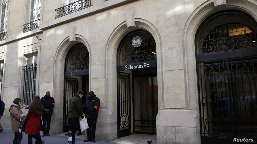 Students are seen outside Paris' Sciences Po university in Paris
