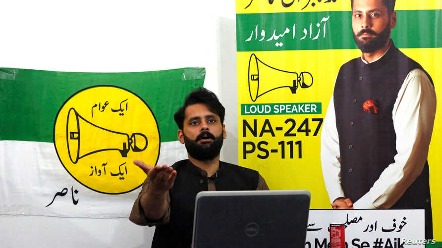 Jibran Nasir, a human rights lawyer and independent candidate for general election, gestures as he speaks at his office in…