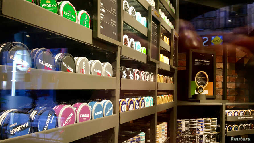 "Moist powder tobacco ""snus"" cans are seen on shelves at a Swedish Match store in Stockholm, Sweden October 24, 2018. Picture…"