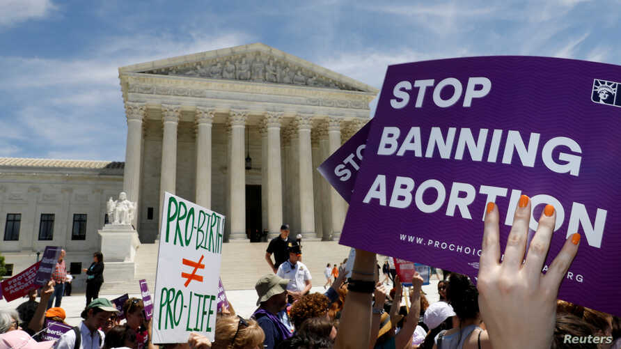 FILE PHOTO: Abortion rights activists rally outside the U.S. Supreme Court in Washington, U.S., May 21, 2019. REUTERS/Kevin…