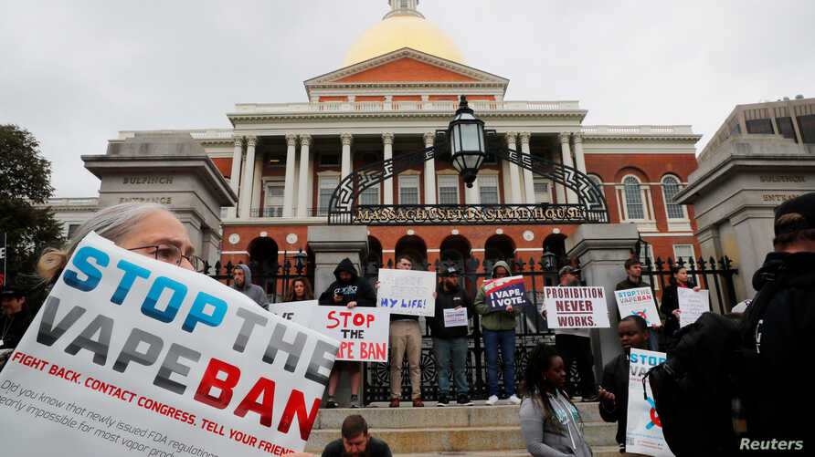 Demonstrators gather at the Massachusetts State House to protest against the state's four-month ban of all vaping product sales…