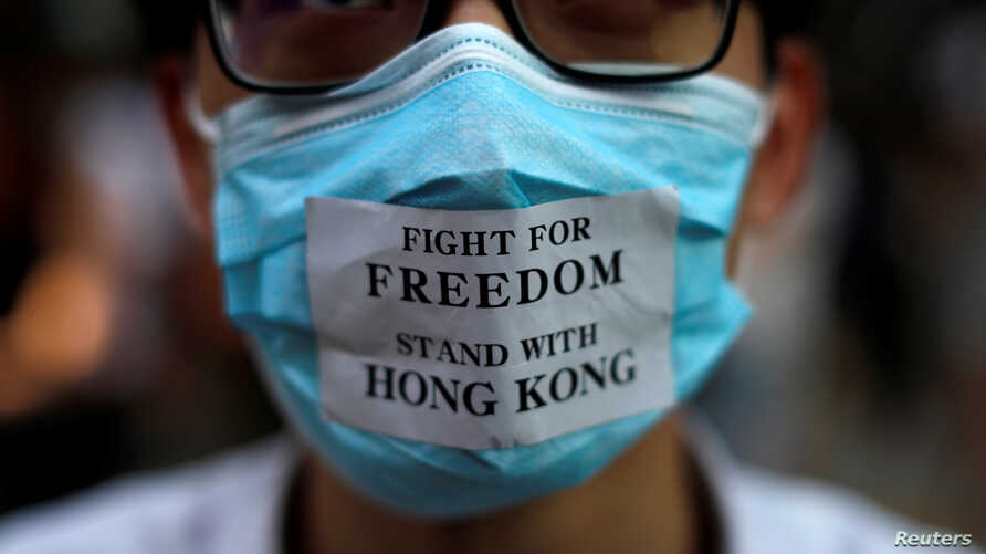 A masked anti-government protester is pictured in Central Hong Kong, China October 4, 2019. REUTERS/Jorge Silva