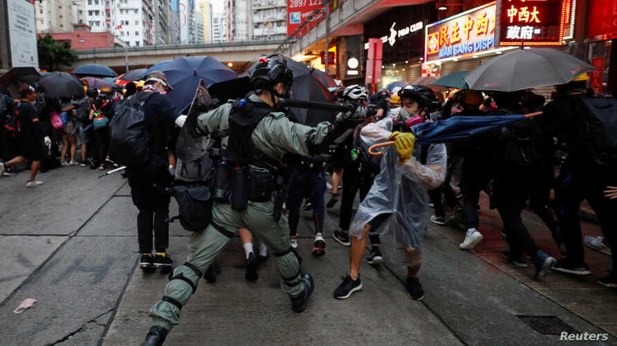 A riot police officer clashes with a protester during an anti-government rally in central Hong Kong, China October 6, 2019…
