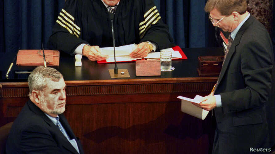 Supreme Court Chief Justice William Rehnquist reads the vote tally in the Senate's impeachment trial of President Clinton, as…