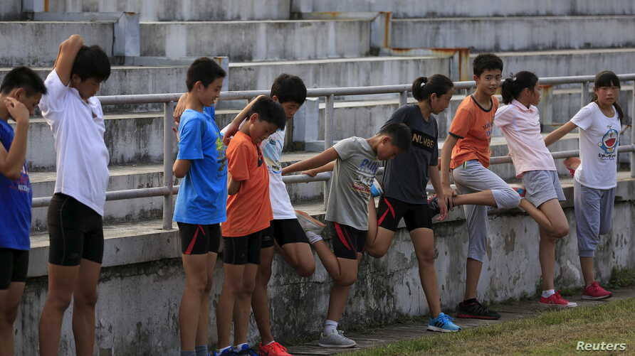 Youths attend a daily track-and-field class, part of a training course at the Jinshan Youth Spare-time Sports School, in…