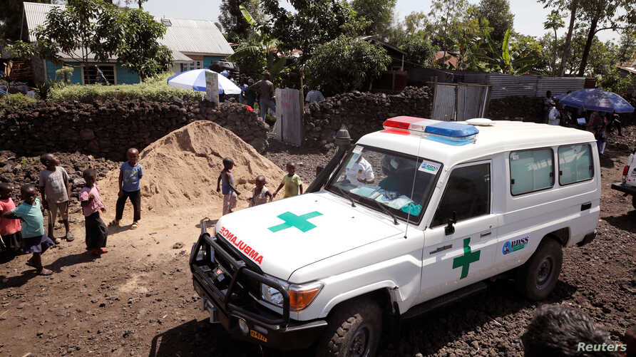 An ambulance waits next to a health clinic to transport a suspected Ebola patient, in Goma in the Democratic Republic of Congo,…