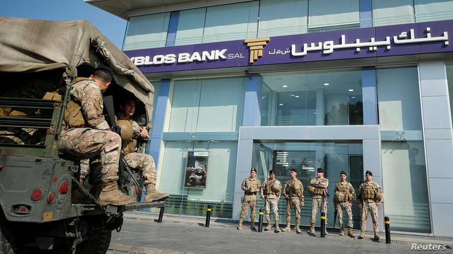 Lebanese army soldiers stand guard outside a branch of Byblos Bank in the southern city of Sidon, Lebanon November 4, 2019. …