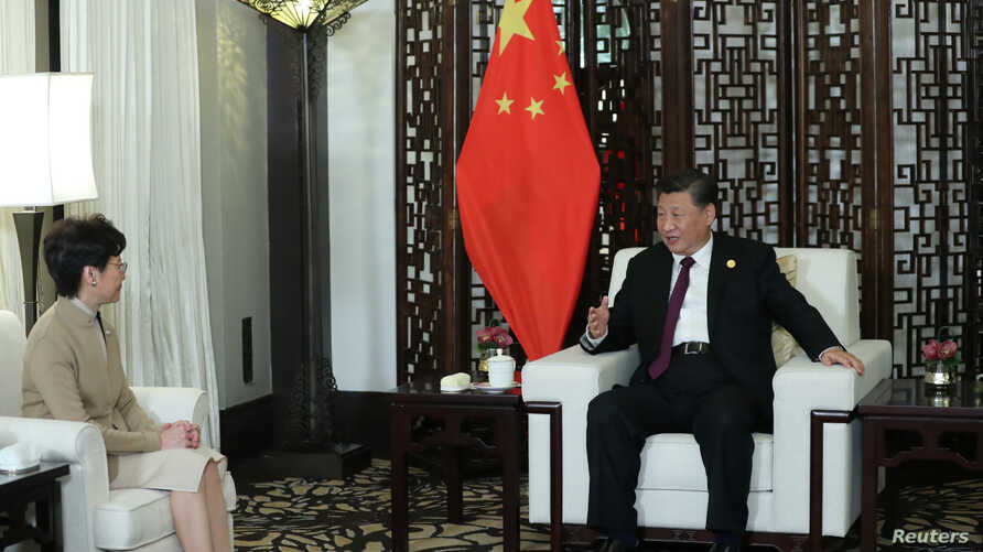 Chinese President Xi Jinping and Carrie Lam