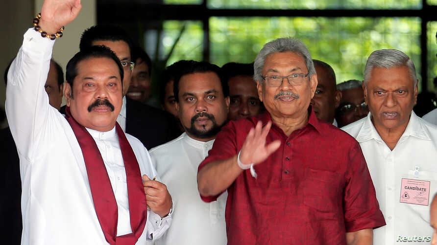 Gotabaya Rajapaksa, Sri Lanka People's Front party presidential election candidate and former wartime defence chief, with his…