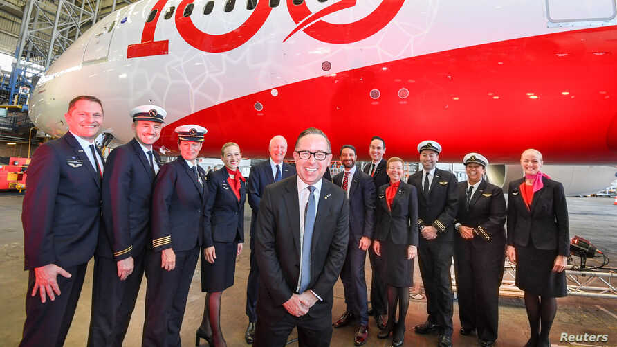 Qantas CEO Alan Joyce (centre) poses with the crew of QF7879, which flew direct from London to Sydney, during the Qantas…