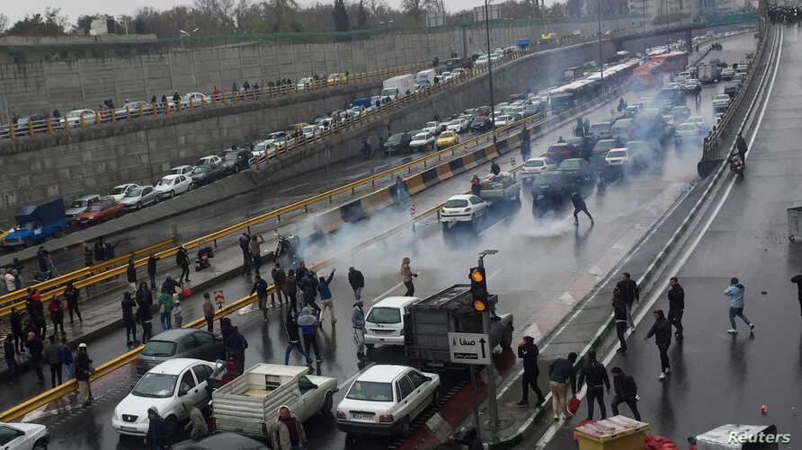 People protest against increased gas price, on a highway in Tehran, Iran November 16, 2019. Nazanin Tabatabaee/WANA (West Asia…