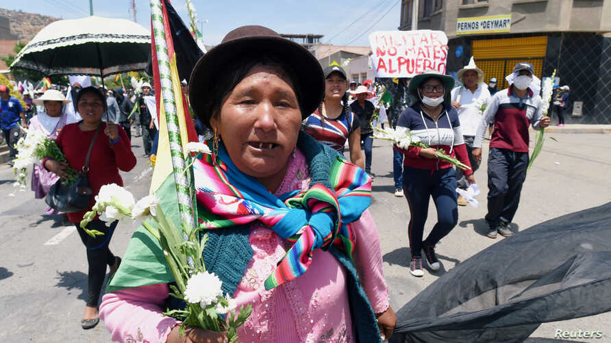 Supporters of former Bolivia's President Evo Morales participate in a march in Cochabamba, Bolivia, Novemver 16, 2019. The sign…