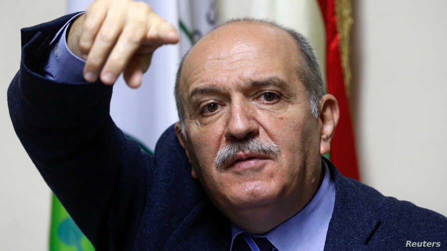 George al-Hajj, president of the federation of syndicates of bank employees gestures during a news conference in Beirut,…