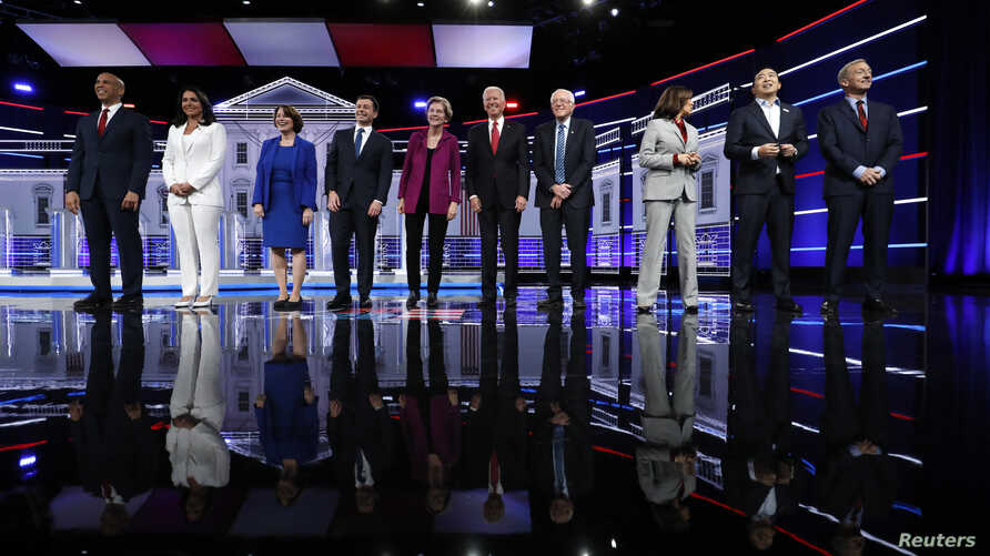 Democratic U.S. presidential candidates Senator Cory Booker, Rep. Tulsi Gabbard, Senator Amy Klobuchar, South Bend Mayor Pete…