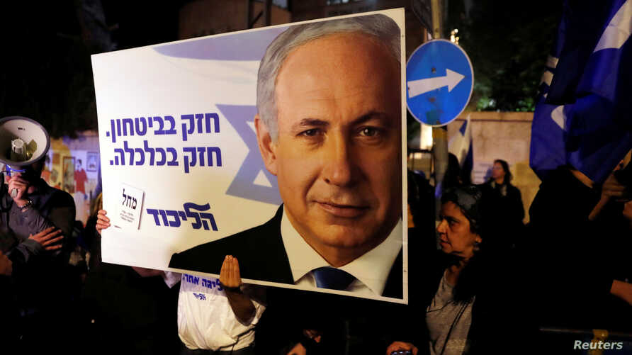 Supporters of Israeli Prime Minister Benjamin Netanyahu protest outside his residence following Israel's Attorney General…
