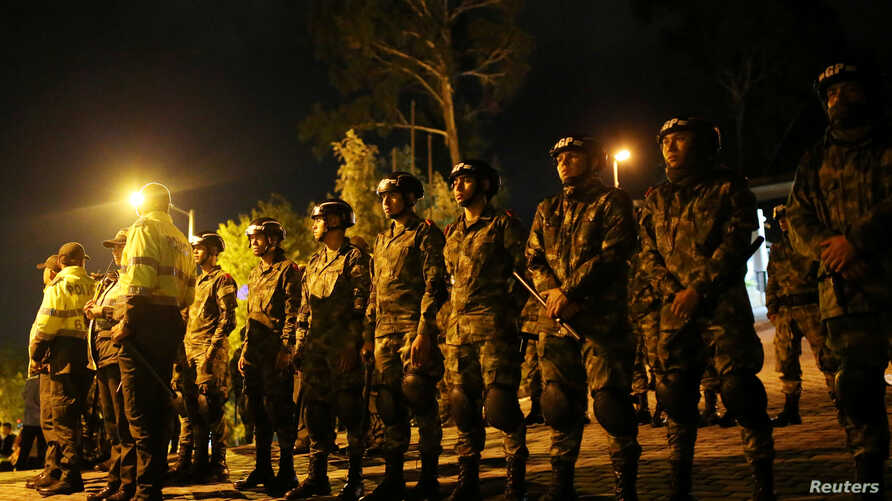 Military personnel stand guard during a protest on the second day of a national strike in Bogota, Colombia, November 22, 2019…